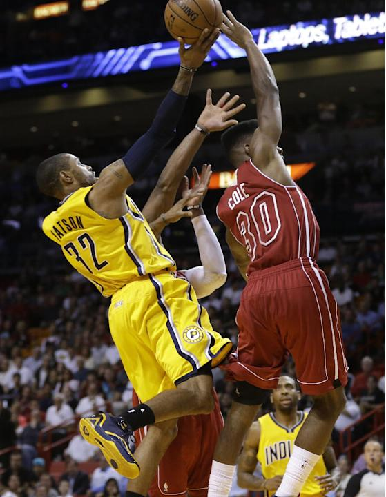 Indiana Pacers' C.J. Watson (32) shoots as Miami Heat's Norris Cole (30) defends during the first half of an NBA basketball game, Wednesday, Dec. 18, 2013, in Miami