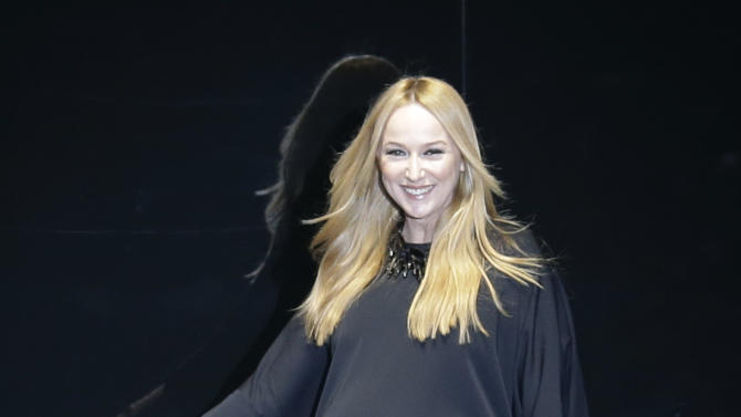 Italian fashion designer Frida Giannini walks on the catwalk at the end of the Gucci women's Fall-Winter 2013-14 collection, part of the Milan Fashion Week, unveiled in Milan, Italy, Wednesday, Feb. 20, 2013. (AP Photo/Luca Bruno)