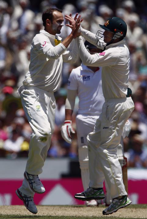 Australia's Lyon celebrates with teammate Bailey after dismissing England's Ballance for 18 runs during the second day of the fifth Ashes cricket test at the Sydney cricket ground