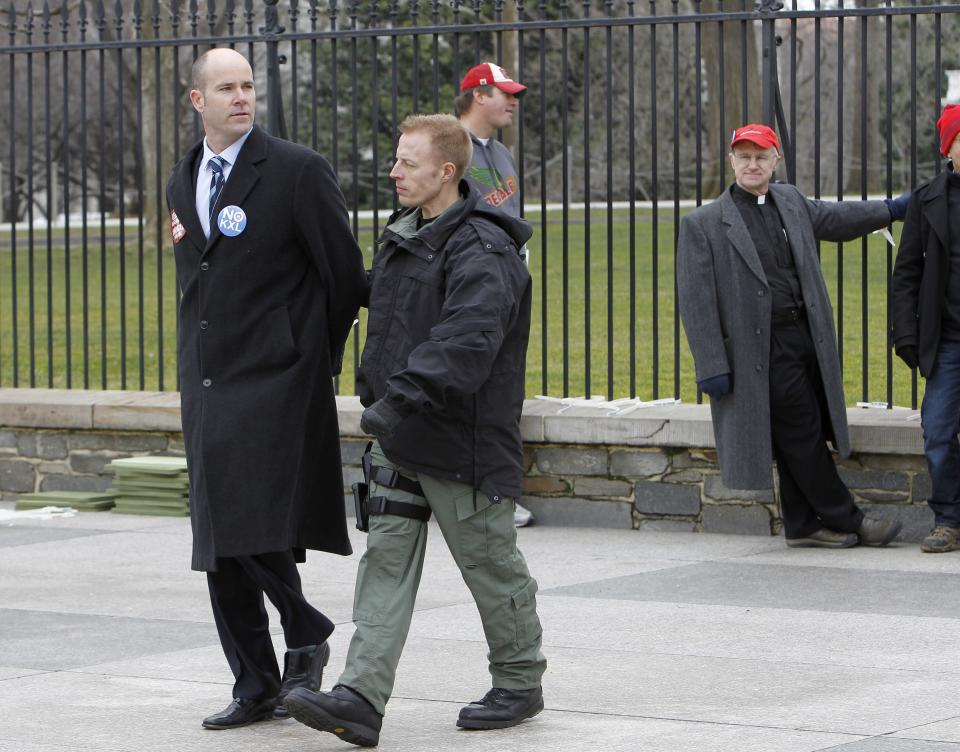 Sierra Club Executive Director Michael Brune is arrested outside the White House in Washington, Wednesday, Feb. 13, 2013, as prominent environmental leaders tied themselves to the White House gate to protest the Keystone XL oil pipeline..  (AP Photo/Ann Heisenfelt)