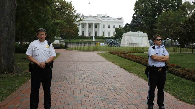 U.S. Secret Service Uniformed Division officers guard an empty Lafayette Park across from the White House during the visit of Israel's PM Netanyahu in Washington