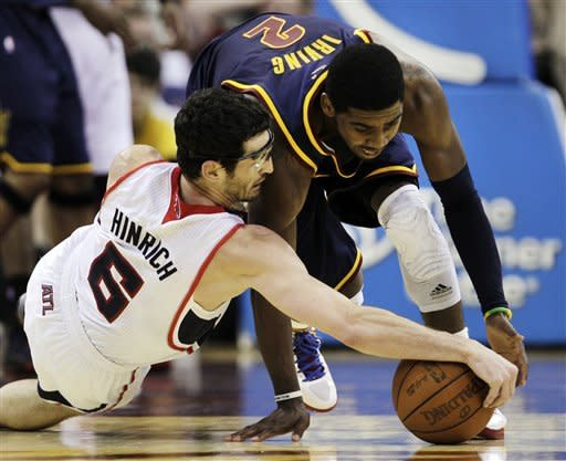 Johnson leads Hawks past Cavaliers, 103-87