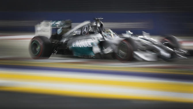 Mercedes driver Lewis Hamilton of Britain steers his car during the Singapore Formula One Grand Prix on the Marina Bay City Circuit in Singapore, Sunday, Sept. 21, 2014. (AP Photo/Ng Han Guan)