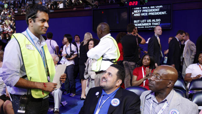 FILE - This Aug. 25, 2008 file photo shows actor Kal Penn, left, talk to national delegates Juan Perez, center, and Bernard Hill while working as a floor whip at the Democratic National Convention in Denver. Celebrities have courted politicians, and vice versa, since the dawn of Hollywood, but what happens when the alliance backfires, when the two worlds are suddenly speaking different languages?  (AP Photo/Matt Sayles)
