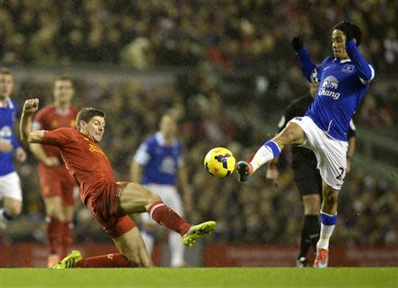 Liverpool's Gerrard challenges Everton's Pienaar during their English Premier League soccer match at Anfield in Liverpool, northern England