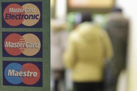Sign with a logo of MasterCard is seen on the door of a branch of Sberbank in Stavropol