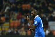 Italy's forward Mario Balotelli reacts during the FIFA 2014 World Cup qualifier between Italy and Denmark on October 16, at the San Siro stadium in Milan. Mario Balotelli's agent says Manchester City contacted him to apologise for their perceived criticism of the controversial striker