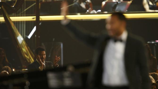 "Musician Richie applauds musician Legend after his performance of ""Easy"" at the 2016 MusiCares Person of the Year gala in Los Angeles"