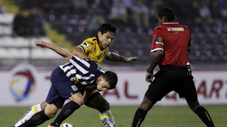 Oyola of Ecuador's Barcelona fights for the ball with Costa of Peru's Alianza Lima during their Copa Sudamericana soccer match in Lima