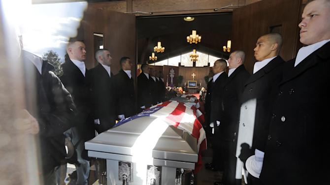 Two Honor Guard carry teams stand next to two flag draped caskets as they arrive at Fort Meyer Memorial Chapel for services to honor two sailors from the Civil War ship, the USS Monitor, Friday, March 8, 2013 in Arlington, Va. A century and a half after the Civil War ship the USS Monitor sank, two unknown crewmen found in the ironclad's turret were buried at Arlington National Cemetery. Friday's burial may be the last time Civil War soldiers are buried at the cemetery. (AP Photo/Alex Brandon)