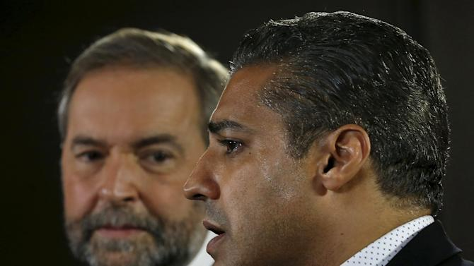 Freed Al Jazeera journalist Mohamed Fahmy speaks at a news conference as Canada's New Democratic Party leader Thomas Mulcair looks on in Toronto