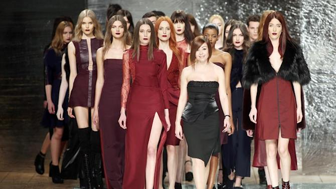 JC. Porto (Portugal), 28/03/2015.- A picture made available on 29 March 2015 shows Portuguese designer Fatima Lopes (C) appearing on the catwalk with models at the end of her show on the fourth day of Portugal Fashion Fall/Winter 2015/2016 in Porto, Portugal, 28 March 2015. (Moda) EFE/EPA/JOSE COELHO