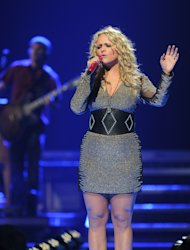 FILE - In this Sept. 21, 2012 file photo, Miranda Lambert performs at the iHeart Radio Music Festival at the MGM Grand Arena in Las Vegas. Brad Paisley and Carrie Underwood co-host the CMA awards show on Thursday, Nov. 1, 2012, at 8 p.m. EDT, live on ABC from the Bridgestone Arena in Nashville. When country music's biggest stars take the stage, you'll see many of your favorites from the last 10 years, though increasingly, new faces are dominating the genre as country's fan base shifts to a younger-skewing audience. (Photo by Eric Reed/Invision/AP)