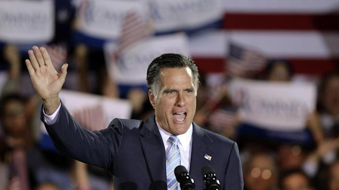 Republican presidential candidate, former Massachusetts Gov. Mitt Romney takes the stage at an election night rally in Manchester, N.H., Tuesday, April 24, 2012. Romney added to his big lead in the race for convention delegates Tuesday with a five-state sweep of Republican presidential primaries. (AP Photo/Jae C. Hong)
