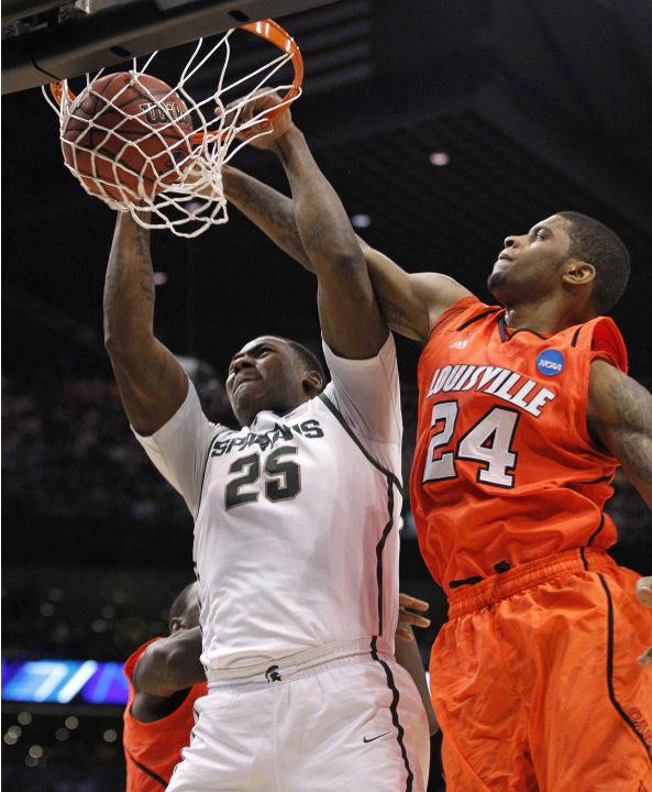 Michigan State's Derrick Nix (25) dunks against Louisville's Chane Behanan during the first half of an NCAA men's college basketball tournament West Regional semifinal on Thursday, March 22, 2012, in 