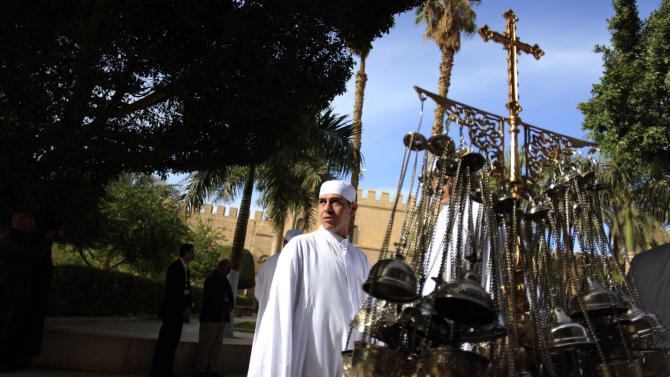 A clergyman stands next to censers during the preparations for the visit of Egypt's Coptic Christian pope, Tawadros II, at  the historic al-Muharraq Monastery, a centuries-old site some 180 miles (300 kilometers) south of Cairo in the province of Assiut, Egypt, Tuesday, Feb. 5, 2013. Egypt's Coptic Christian pope sharply criticized the country's Islamist leadership in an interview with The Associated Press on Tuesday, saying the new constitution is discriminatory and Christians should not be treated as a minority. (AP Photo/Khalil Hamra)