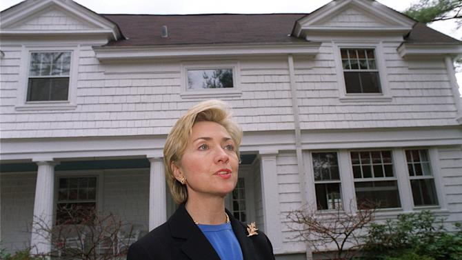 FILE - In this Nov. 3, 1999, file photo, then-first lady Hillary Rodham Clinton speaks to the media in front of the Clinton's newly purchased home in Chappaqua, N.Y., The server computer that transmitted and received Hillary Clinton's emails on a private account she used exclusively for official business when she was secretary of state traced back to a residential Internet service registered at her family's five-bedroom home in Chappaqua, according to Internet records reviewed by The Associated Press.  (AP Photo/Stephen Chernin, File)