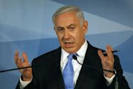 Israeli Prime Minister Benjamin Netanyahu gives a press conference marking the start of his fourth year in power in Jerusalem. The global campaign of imposing sanctions against Iran has so far failed to halt Tehran's controversial nuclear drive, Netanyahu said on Tuesday