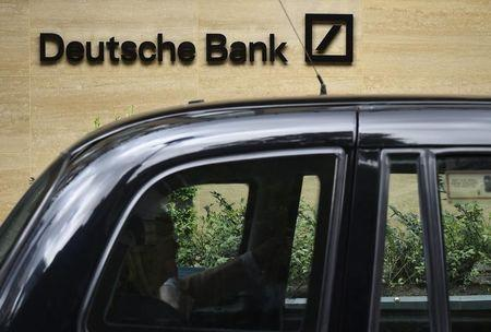 A taxi drives past the London headquarters of Deutsche Bank in the City of London