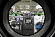 <p> FILE - In this Monday, Sept. 10, 2012 file photo, dryers are seen from the inside of another clothes' dryer, foreground, at a Lowe's store, in Framingham, Mass. The Commerce Department reports on business orders for durable goods in July, on Monday, Aug. 26, 2013 (AP Photo/Steven Senne, File)