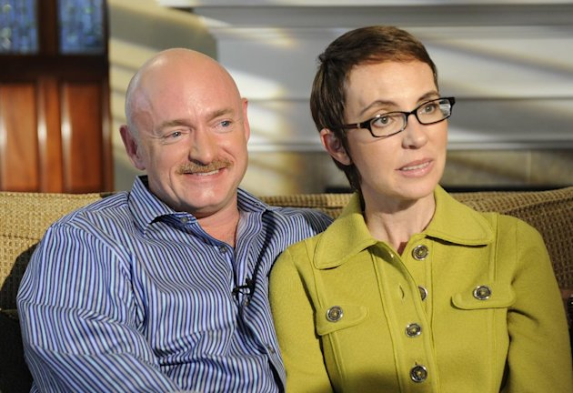 FILE - In this undated photo provided by ABC, U.S. Rep. Gabrielle Giffords and husband Mark Kelly are interviewed by Diane Sawyer on ABC's 20/20.   One year after being shot in the head, Rep. Gabriell