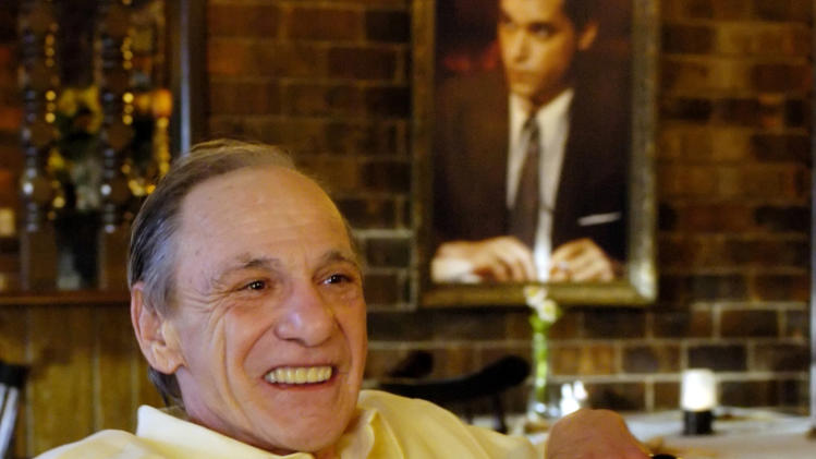 "FILE - In this Feb. 22, 2005 file photo, Henry Hill sits in the dining room of the Firefly restaurant in North Platte, Neb., with a portrait of actor Ray Liotta portraying Hill in the movie ""Goodfellas"" hanging on the wall behind him. Hill, whose life as a mobster and FBI informant was the basis for the Martin Scorcese film, has died. Hill's girlfriend Lisa Caserta says he died in a Los Angeles hospital after a long illness. He was 69. (AP Photo/Nati Harnik, File)"