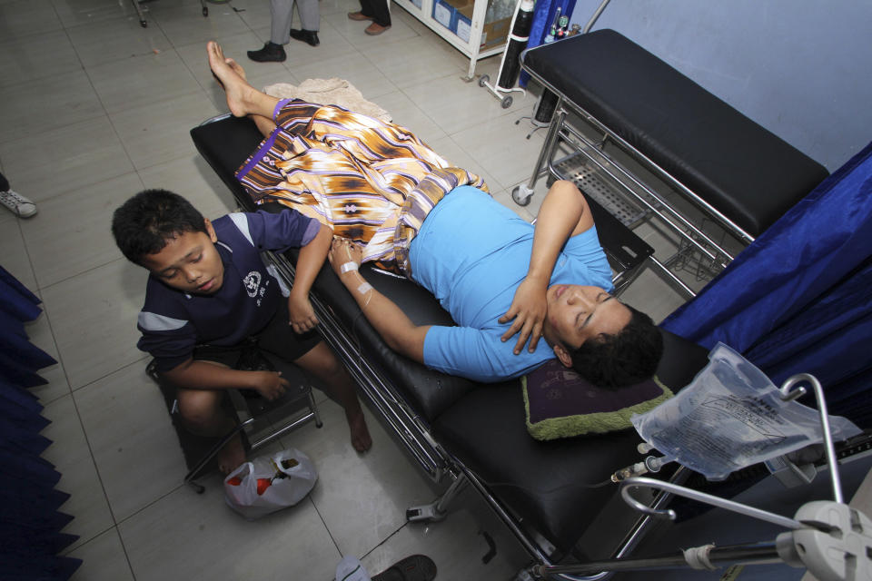 Survivors of a ferry accident on Sunda straits receive medical treatment at a hospital in Cilegon, Banten province, Indonesia, Wednesday, Sept. 26, 2012. A passenger ferry collided with a cargo ship and sank west of Indonesia's main island Wednesday morning, and at least eight people were killed, officials said. (AP Photo)