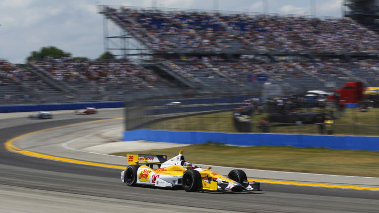 Ryan Hunter-Reay drives on his way to the win in the IndyCar auto race at the Milwaukee Mile in West Allis, Wis., Saturday, June 16, 2012. (AP Photo/Jeffrey Phelps)