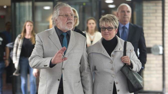 Former Radio 1 DJ, Dave Lee Travis, real name David Patrick Griffin, and his wife Marianne Griffin leave Southwark Crown Court in London