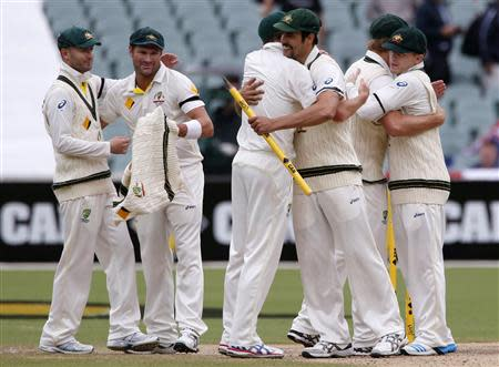 Australia's captain Clarke and Harris celebrate with team mates after winning the second Ashes cricket test against England at the Adelaide Oval