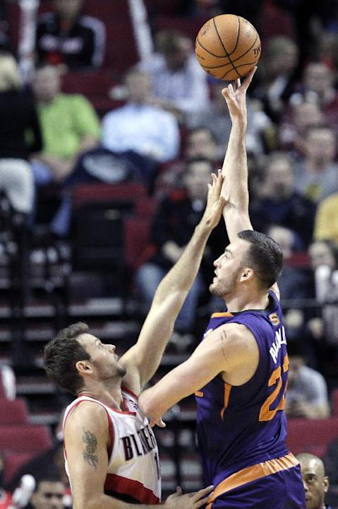 Phoenix Suns center Miles Plumlee, right, shoots over Portland Trail Blazers forward Joel Freeland during the second half of an NBA preseason basketball game in Portland, Ore., Wednesday, Oct. 9, 2013