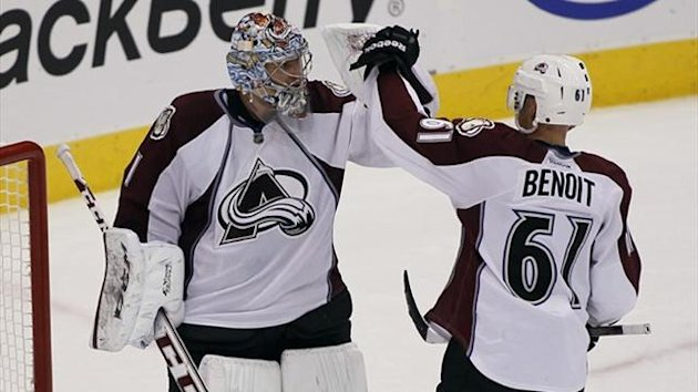Colorado Avalanche defenseman Andre Benoit (61) congratulates goaltender Semyon Varlamov (1) after a win over the Toronto Maple Leafs at the Air Canada Centre (Reuters)