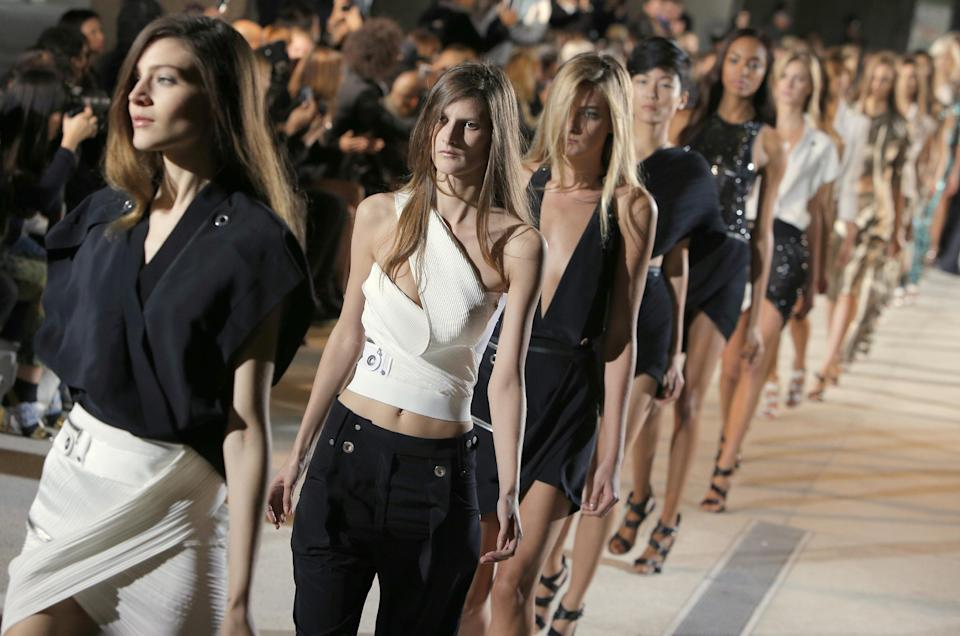 Models wear a creation as part of fashion designer Anthony Vaccarello's spring-summer 2013 ready to wear collection in Paris, Tuesday, Sept. 25, 2012.  (AP Photo/Francois Mori)