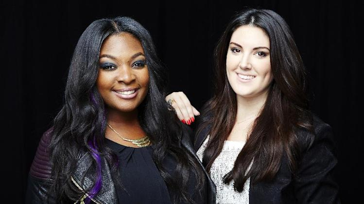 "This May 20, 2013 photo shows Candice Glover, left, and Kree Harrison posing for a portrait in New York. Glover is the latest winner on the singing competition series, ""American Idol."" Harrison was the runner-up. (Photo by Dan Hallman/Invision/AP)"