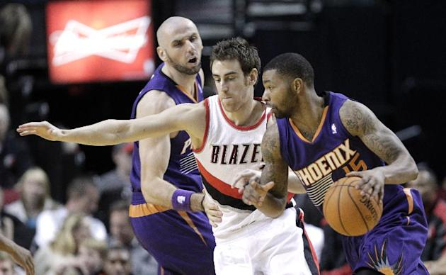 Phoenix Suns forward Marcus Morris, right, drives on Portland Trail Blazers forward Victor Claver, from Spain, as Suns center Marcin Gortat, left, sets a screen during the second half of an NBA presea