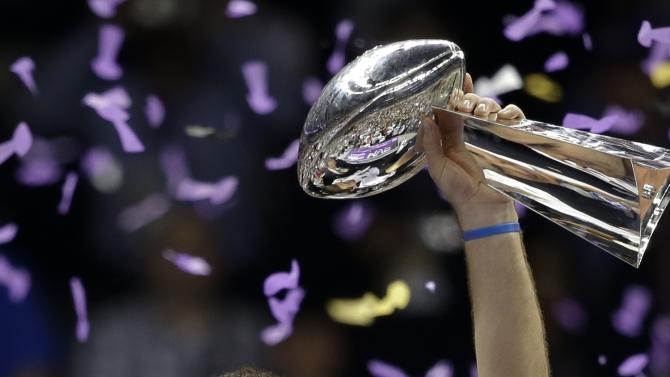 Baltimore Ravens quarterback Joe Flacco holds up the Vince Lombardi Trophy after their 34-31 win against the San Francisco 49ers in the NFL Super Bowl XLVII football game, Sunday, Feb. 3, 2013, in New Orleans. (AP Photo/Marcio Sanchez)