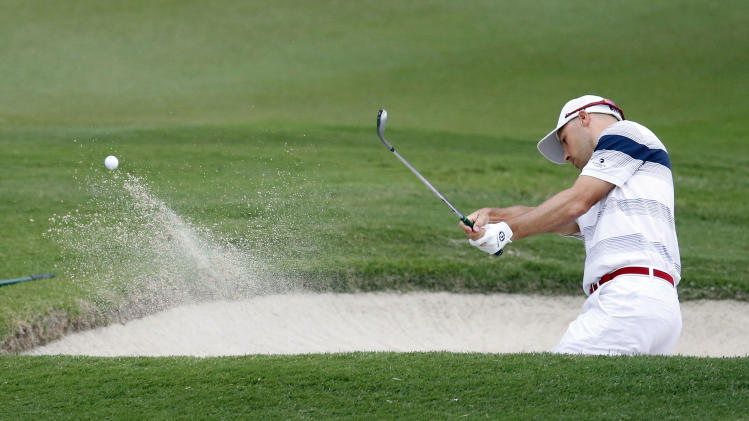 Ben Crane hits out of the sand trap on the seventh hold during the second round of the St. Jude Classic golf tournament Friday, June 7, 2013, in Memphis, Tenn. (AP Photo/Rogelio V. Solis)