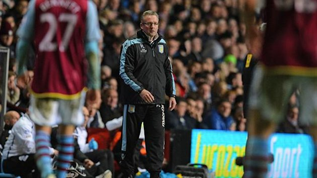 Aston Villa boss Paul Lambert (C) looks on during the Premier League loss to Newcastle United (AFP)