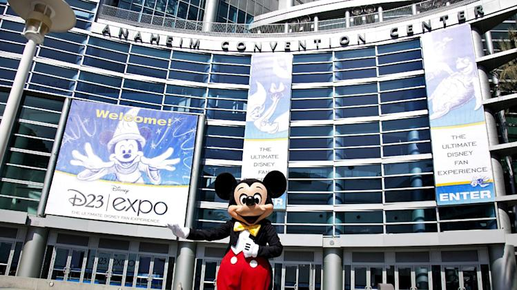 "FILE - In this Sept. 9, 2009 handout photo released by Disney, Mickey Mouse stands in front of the Anaheim Convention Center in preparation for the Disney D23 Expo in Anaheim, Calif. The Walt Disney Co. is cracking open the vault, rolling out the red carpet and pulling back the curtain for more than 45,000 expected fans at this weekend's D23 Expo, Aug. 9-11, 2013, a three-event celebration of all things Disney at the Anaheim Convention Center. On the animation front, the studio will showcase Walt Disney Animation Studios' computer-generated adventure ""Frozen"" and Pixar's prehistoric comedy ""The Good Dinosaur"" during a Friday presentation, as well as the ""Finding Nemo"" sequel ""Finding Dory,"" the manga-style Marvel adaptation ""Big Hero 6"" and the new Mickey Mouse short film ""Get a Horse!"" (AP Photo/Disney, Scott Brinegar, File)"