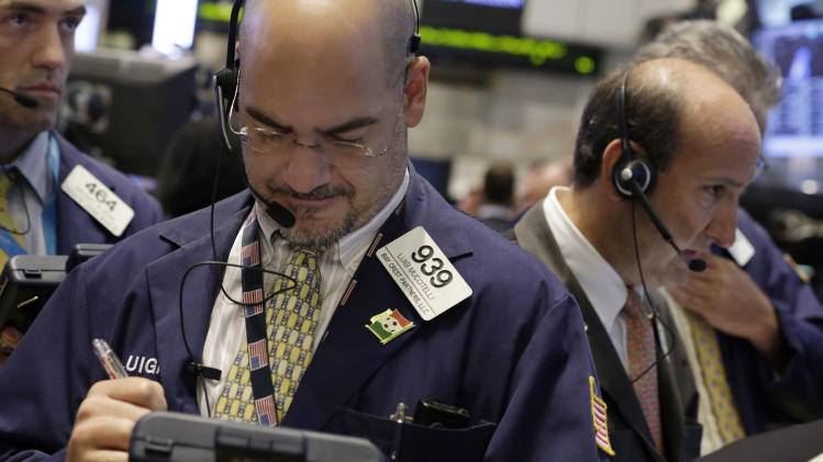 In this Tuesday, Aug. 27, 2013 photo, Luigi Muccitelli, center, works with fellow traders on the floor of the New York Stock Exchange. (AP Photo/Richard Drew)