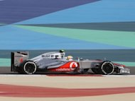 McLaren Mercedes' British driver Lewis Hamilton drives at the Bahrain International circuit in Manama during the Bahrain Formula One Grand Prix. Hamilton warned his McLaren team on Sunday that they need to investigate and fix their pit-stop problems before they wreck their bid for the world championship