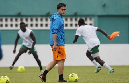 Sierra Leone's national soccer team coach Johnny Mckinstry supervises a training session at the Felix Houphouet Boigny stadium in Abidjan
