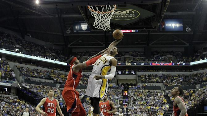 Indiana Pacers' Paul George (24) goes up for a dunk against Atlanta Hawks' Josh Smith (5) during the second half of Game 5 in the first round of the NBA basketball playoff series on Wednesday, May 1, 2013, in Indianapolis. Indiana defeated Atlanta 106-83. (AP Photo/Darron Cummings)