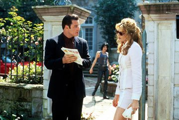 John Travolta and Rene Russo in MGM's Get Shorty