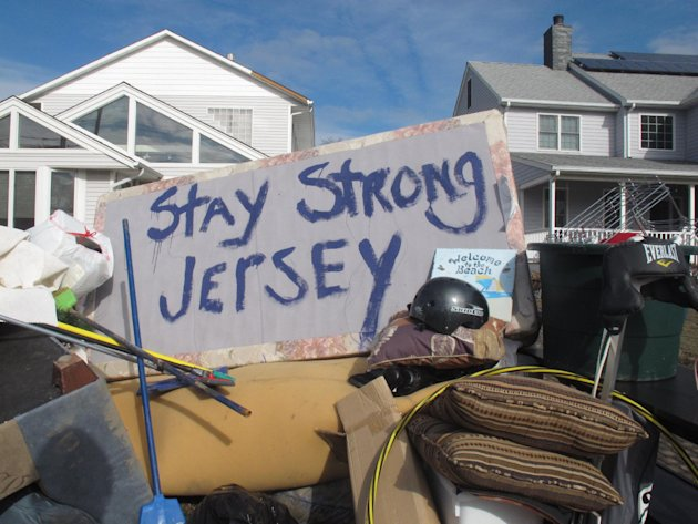 Residents of a flood-wrecked home in Point Pleasant Beach N.J. offer encouragement to fellow victims of Superstorm Sandy on Monday, Nov. 5, 2012, in this message scrawled on the bottom of a waterlogge