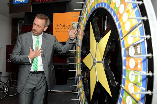 "Hugh Laurie of ""House"" spins the wheel for charity at the 2011 Fox Fall Eco-Casino Party at The BookBindery on September 12, 2011 in Culver City, California."