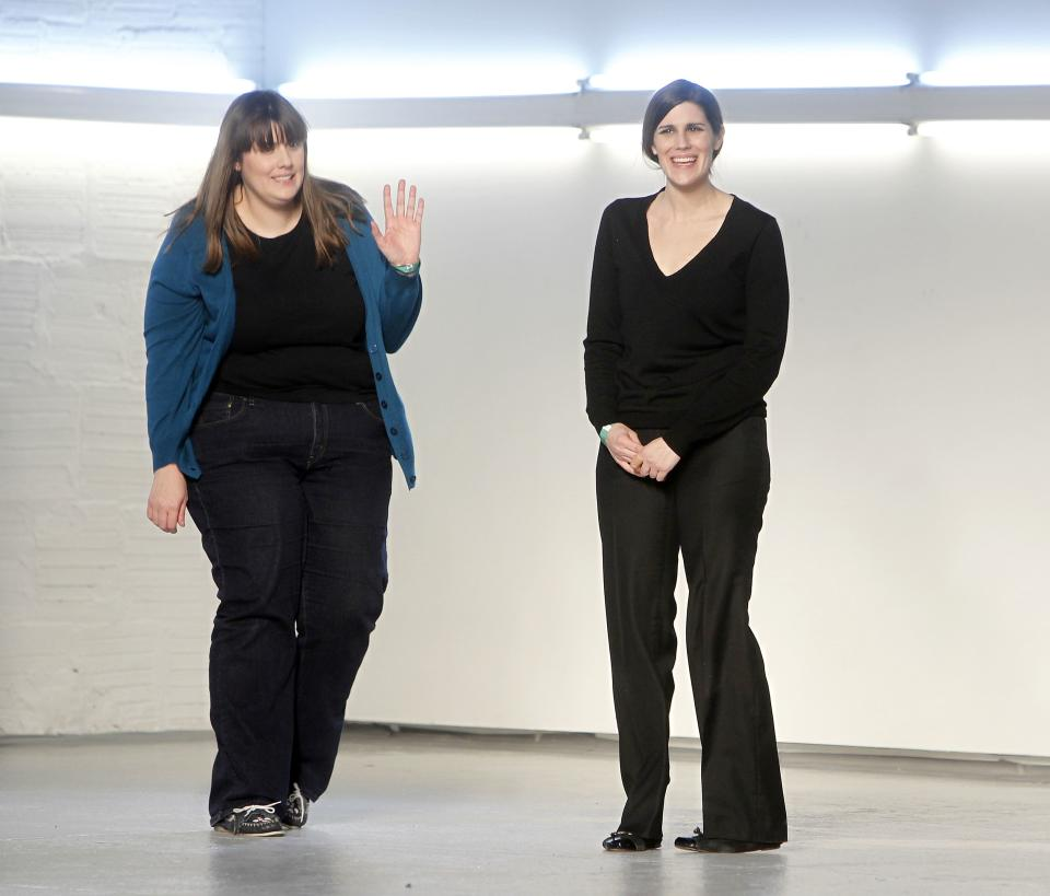 Designers Kate Mulleavy, left, and her sister Laura acknowledge the audience after the Rodarte fall 2012 collection show during Fashion Week, Tuesday, Feb. 14, 2012, in New York. (AP Photo/Jason DeCrow)