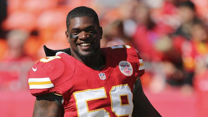 FILE - In this Oct. 7, 2012, file photo, Kansas City Chiefs inside linebacker Jovan Belcher smiles before an NFL football game against the Baltimore Ravens in Kansas City, Mo. Belcher was apparently worried he would lose his baby and money to his longtime girlfriend before fatally shooting her and killing himself, according to newly released police reports. (AP Photo/Ed Zurga, File)