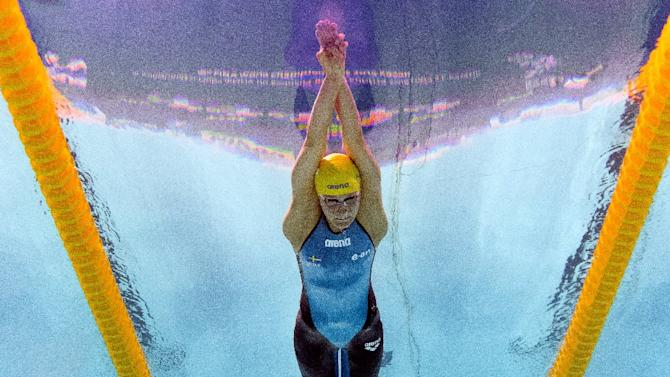 Picture taken with an underwater camera shows Sweden's Sarah Sjostrom competing in the final of the women's 100m butterfly swimming event at the 2015 FINA World Championships in Kazan on August 3, 2015