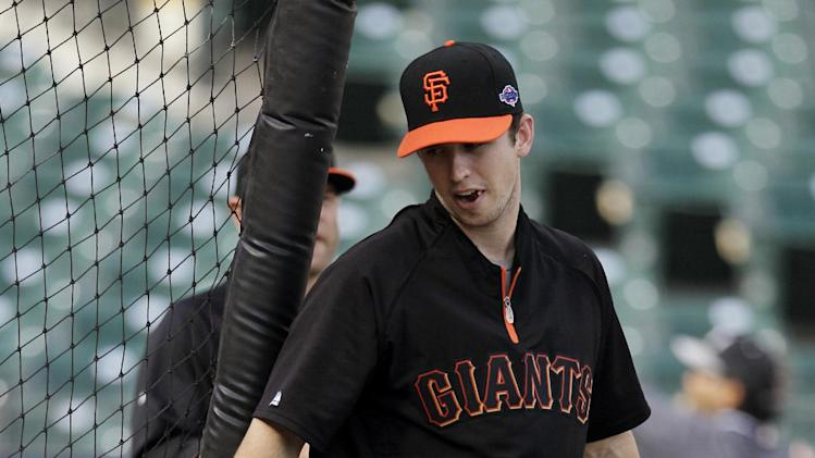San Francisco Giants' Buster Posey heads to the batting cage before Game 7 of baseball's National League championship series against the St. Louis Cardinals Monday, Oct. 22, 2012, in San Francisco. (AP Photo/Mark Humphrey)